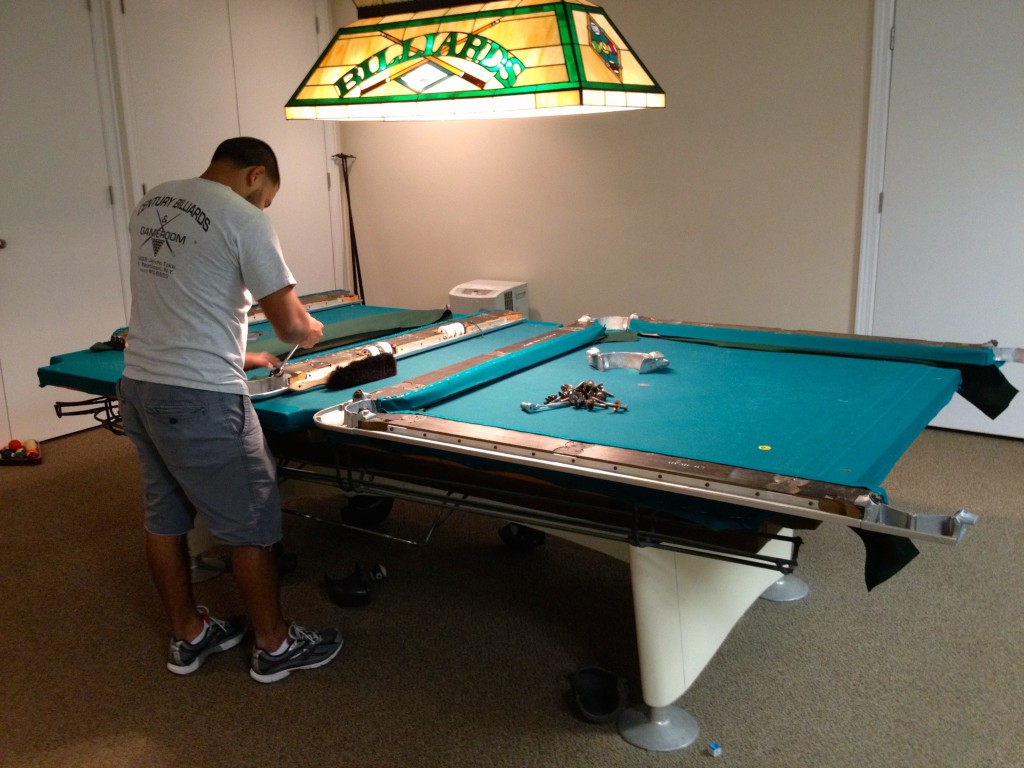 man building a pool table