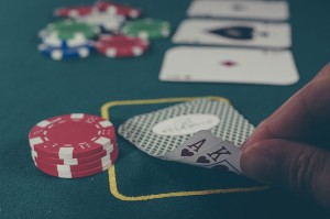 poker cards and chips on a poker table