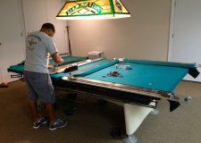 Man assembling a pool table